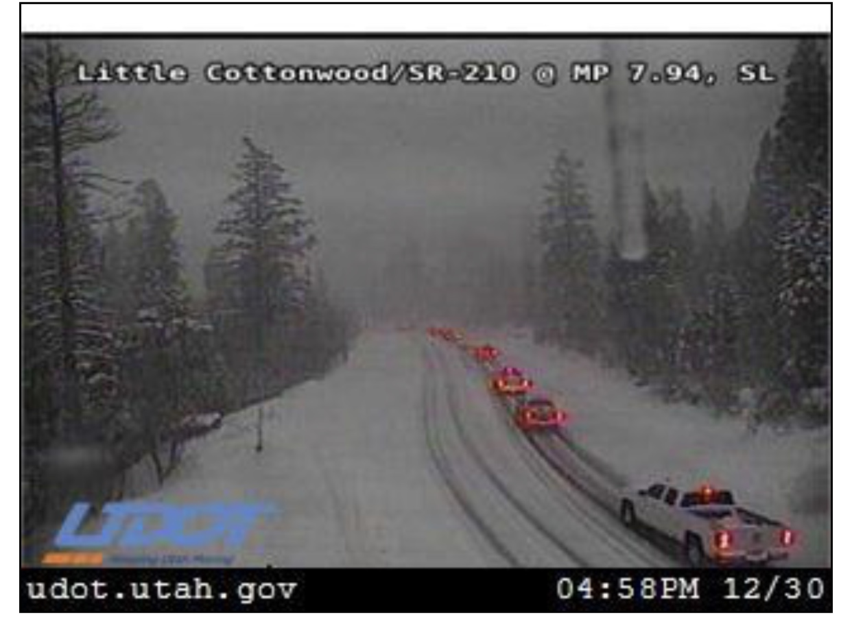 UDOT cam showing traffic creeping down a snowy Little Cottonwood Canyon this evening. (www.utahcommuterlink,com)