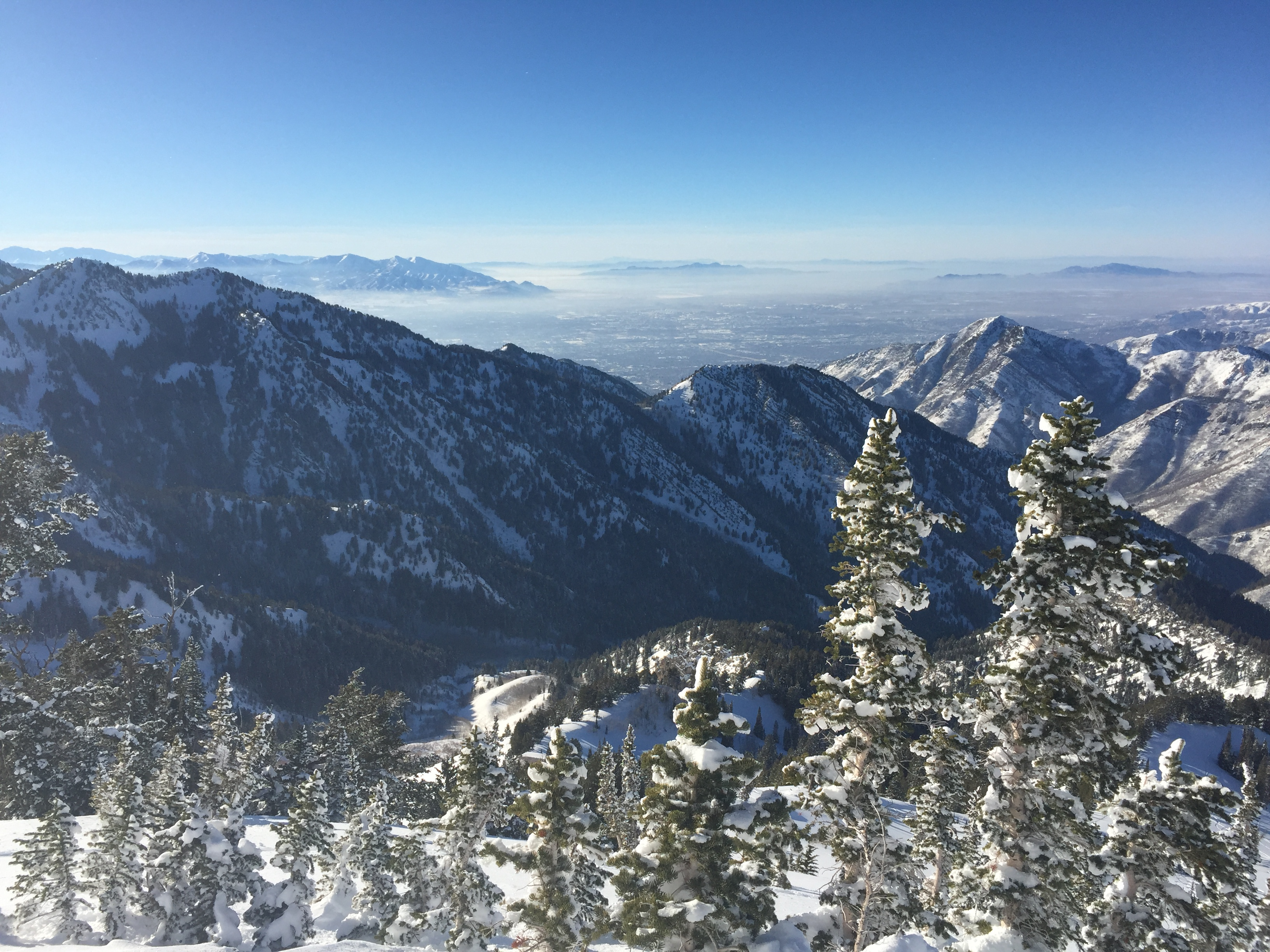 Gorgeous mountain views of the Salt Lake valley and beyond. Note the layer of haze hanging out near the  surface at the top of the boundary layer.