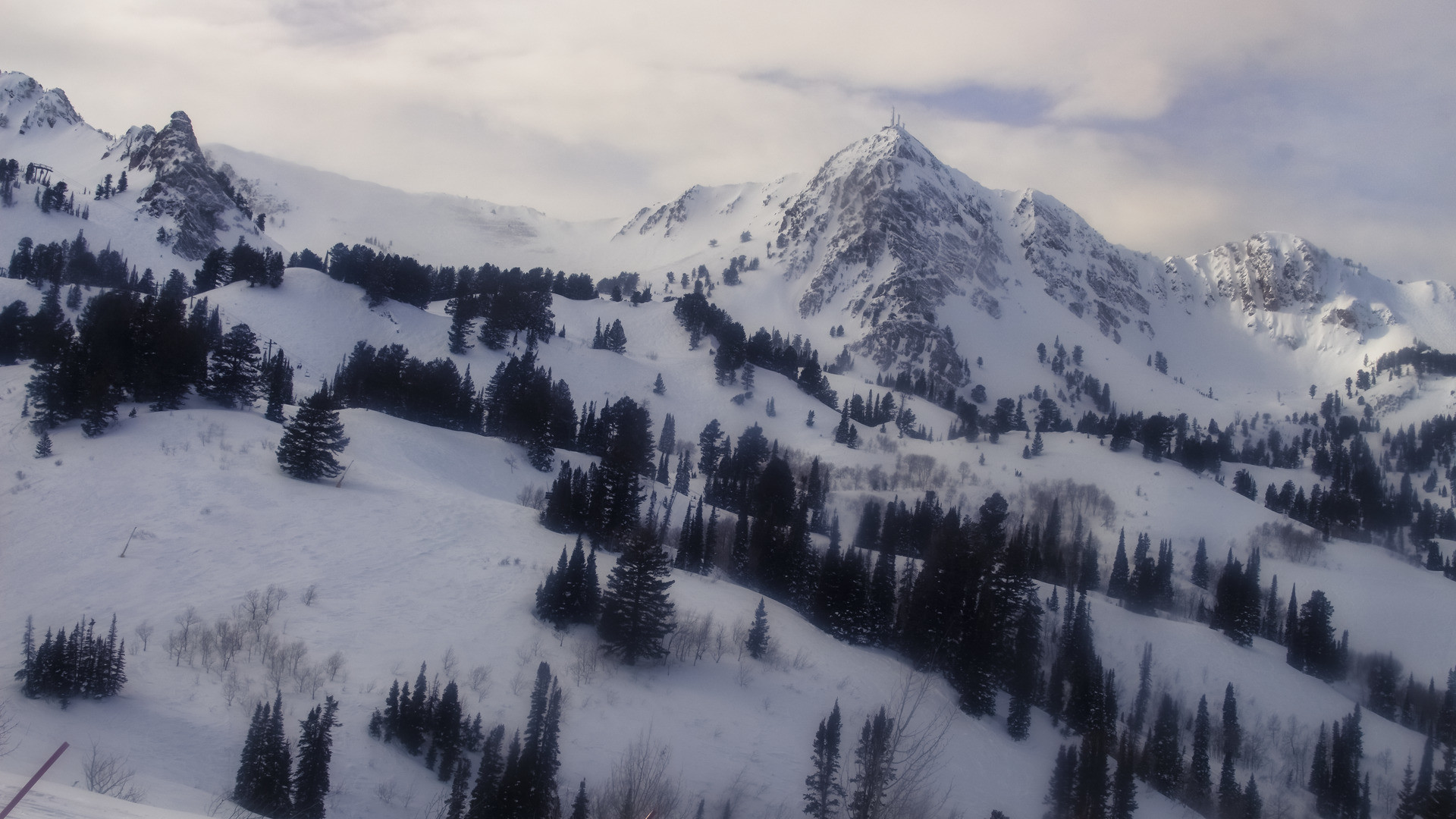 View from Snowbasin Resort this afternoon. Mostly cloudy with the sun peaking through. Courtesy: snowbasin.com