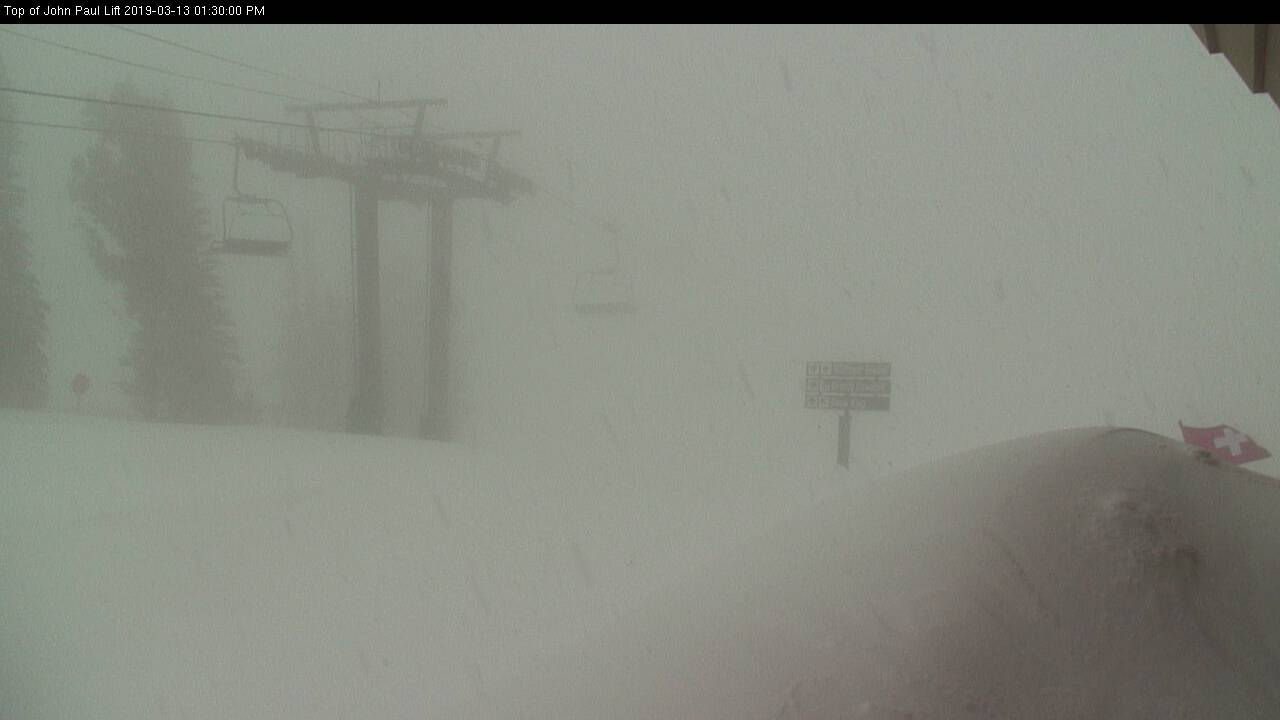 View from Snowbasin Resort this afternoon. Heavy snow with low visibility and very strong winds. Courtesy: snowbasin.com